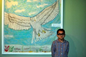 Gabriel Diaz with his artwork. Photo by Zachary Croce, South Berganite.