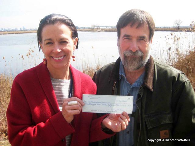 Don Torino of BCAS presents a check for $3780 to NJMC Landscape Architect Katy Weidel.